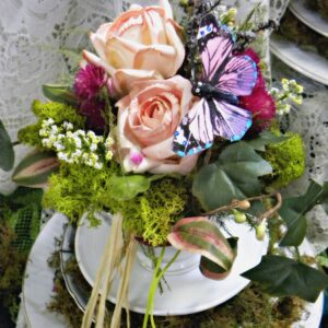 vintage tea cups of moss and flowers