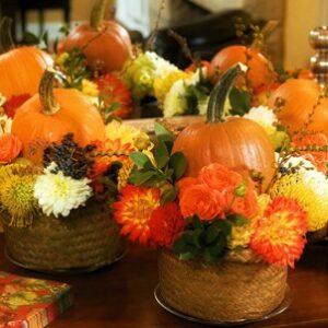 flower basket with pumpkins